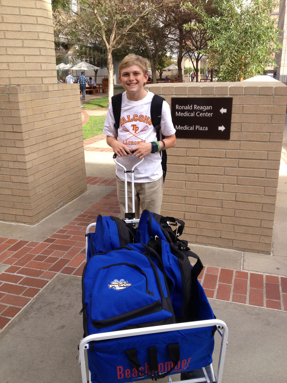 Bringing the goods! Nick delivering backpacks to UCLA Childrens